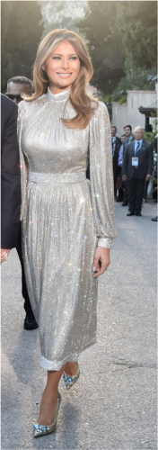 Melania stuns in this silver Dolce & Gabbana high-neck gown in Sicily