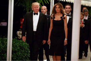 Melania wears Dolce & Gabbana to a New Year's Eve party in Palm Beach, Florida